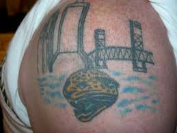 "3) Just classic jags/Jacksonville imagery. Probably one of the better Jags tats I could find, in spite of its obvious poor artistic quality and fading. Bro should get a pro touch-up. I still give it a ""I'd do."" And as a person with 0 tats myself, that's saying a lot."