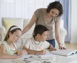When and How Much Parents Should Help With Homework Work at Home Moms   About com Mother helping children with homework   Tetra Images Getty Images