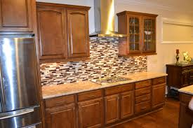 Kitchen Cabinet Decor Ideas by Pale Green Walls And Under Cabinet Lighting Add Character To This