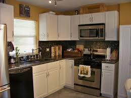 L Shaped Small Kitchen Designs Small Kitchen Design With White L Shaped Kitchen Cabinet And Grey