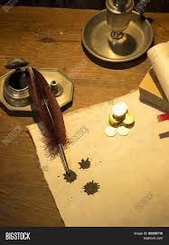 old style writing paper antique parchment paper sheets lit by candlelight on a vintage antique parchment paper sheets lit by candlelight on a vintage colonial wood desk with ink writing