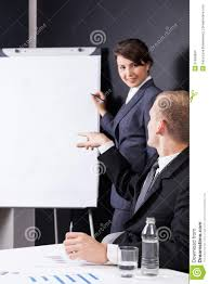 Manager writing on paper board Dreamstime com