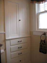 white wooden double door storage cabinet on gray painted wall room