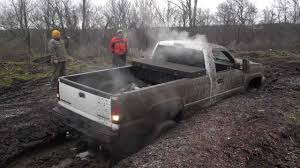 monster trucks in the mud videos super awesome lifted chevy silverado 2500 mud bogging