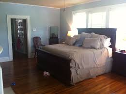 interior elegant bedroom furniture with light brown wooden wall