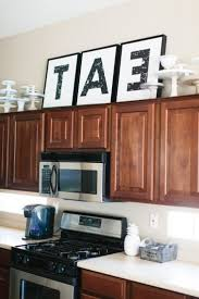 Top Of Kitchen Cabinet Decor Ideas Kitchens 1000 Ideas About Above Cabinet Decor On Pinterest