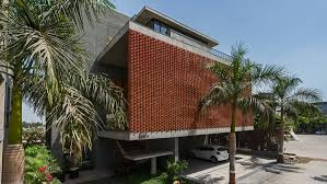 rippling red brick facade shades house in surat by design work group