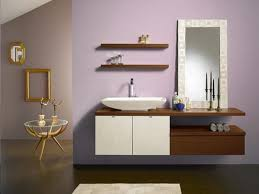 teak floating shelves over toilet with symmetrical display of