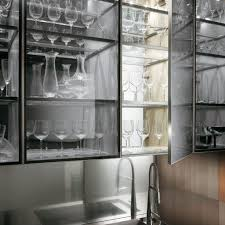 Modern Luxury Kitchen Designs by Transparent Glass Cabinet With A Kitchen Faucet In A Natural