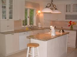 Santa Cecilia Granite With White Cabinets