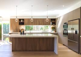 large modern contemporary kitchen in warm tones with a huge