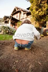 Little girls bent over|Shutterstock