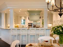 inspiring white kitchen idea with bamboo chairs also shiny range