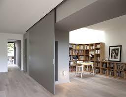 sleek home office sliding door also home library area inspiring