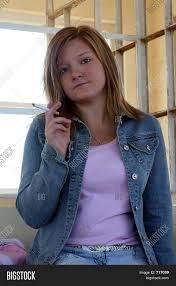 beautiful teen smoking in a bus shelter stock photo u0026 stock