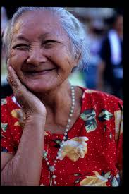 image of an old woman with smiling eyes