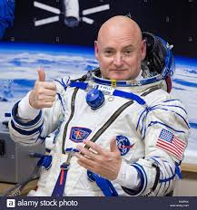 expedition 43 nasa astronaut scott kelly gives a thumbs up as he
