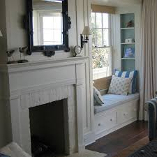 painted brick fireplace surround window seat next to fp with side