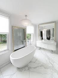 bathroom black tile freestanding bathtub white tile flooring
