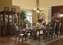 Teak Dining Room Table And Chairs by Carved Brown Stained Teak Wood Dining Table Under Antique