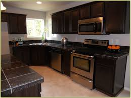 White Kitchen Cabinets With Black Granite Countertops by White Kitchen Cabinets With Dark Granite Countertops Home Design