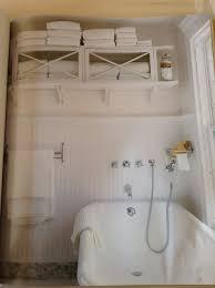 bathroom glamorous bathroom towel storage in white theme also glamorous bathroom towel storage in white theme also porcelain tub over window