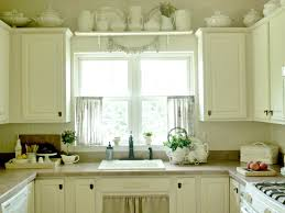 kitchen the kitchen space is beautiful with window dressing