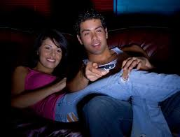 Can You Fall in Love on Your First Date Young couple watching television