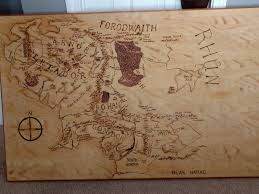 map of middle earth burned into a tabletop by my brother in law