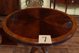 high end mahogany dining table in a walnut finish 48 to 66