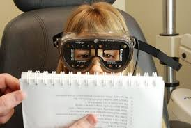 Elise Pelletier looks through the Visagraph googles to read text on a page  The goggles are an infrared tracking system  allowing optometrist Patrick Quaid     Guelph Mercury