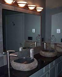 round lighting sconces over big mirror for bathroom vanity part