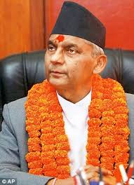 Chief Justice Khil Raj Regmi has been sworn in as Nepal's new prime minister to head an interim government, which will hold elections by June 21 - article-2313651-19735C53000005DC-975_306x423