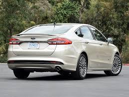 Ford Fusion Hybrid Titanium rear quarter right photo JD Power