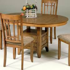 oval pedestal table with storage base by liberty furniture wolf