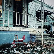 Tricycle in front of the home of Portia Armour  a mother of four  who