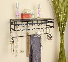 tiny necklace wall organizer and black color plus parfume on top