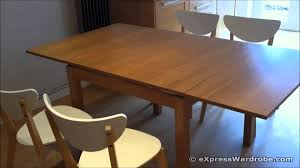calais extending dining room table and 4 solid wood chairs of