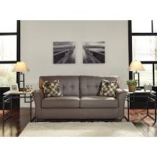 contemporary sofa with tufted back by signature design by ashley