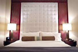 giant tufted headboard grey white orange bedroom pinterest