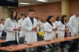 Doctor of Nursing Practice students recite the Student Oath of Responsibility as part of their transition from pre clinical coursework to advanced clinical