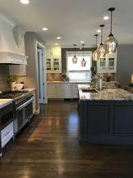 Kitchen Island Lamps White Cabinets Granite Island Dark Wood Floor Gray Glazed