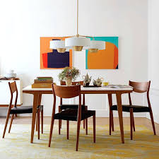 modern extendable dining table with glass top and metal base