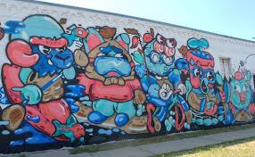 twenty amazing new street art murals painting in denver in summer detail of the new plaant mural