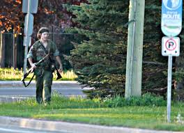 Hunt on for Canadian suspected in police killings   Daily Mail Online Daily Mail A heavily armed man that police have identified as Justin Bourque walks on Hildegard Drive in