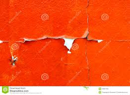 old cracked orange paint background texture wall stock photo