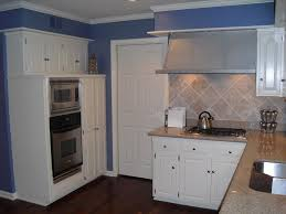 White Kitchen Cabinets With Black Granite Countertops by Pictures Granite Kitchen Countertops Off White Cabinets With Dark