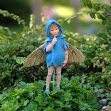 outdoor garden with little fairy statue fairy statues to