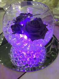 Purple Floating Candles For Centerpieces by Best 25 Centerpieces Ideas On Pinterest Wedding Centerpieces