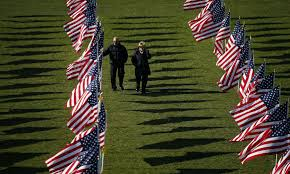 Jack Amwoza  L  and his wife Carlene walk through some of the two thousand and thirteen United States flags that are part of the Aurora Healing Fields      Business Insider